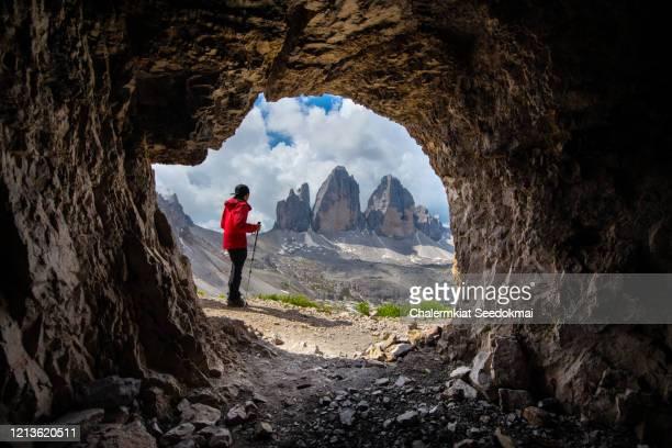 a man hiking at tre cime di lavaredo - drei zinnen, italy - トレチーメディラバレード ストックフォトと画像