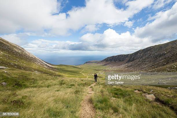 Man hiking in Mountain Valley, Scotland