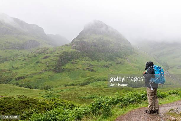 Man hiking in mountains.