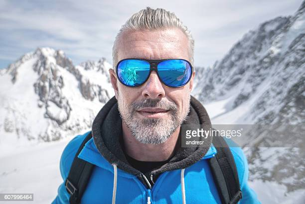 Man hiking in snow mountains
