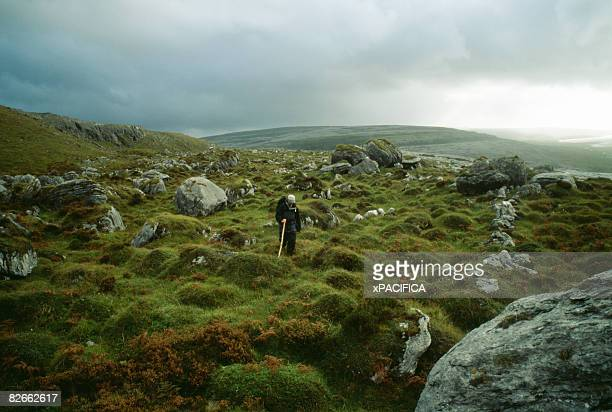 A man hiking in the Burren in Ireland.
