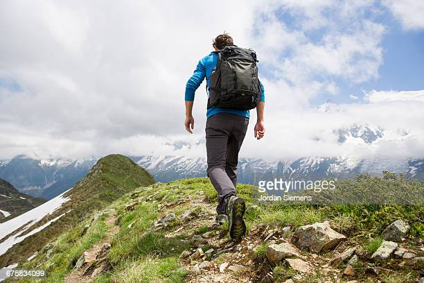 A man hiking in the mountains.