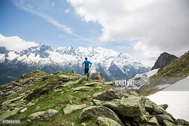 a man hiking in the mountains. - chamonix stock pictures, royalty-free photos & images