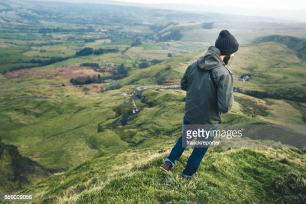 man hiking in the peak district - winter coat stock pictures, royalty-free photos & images