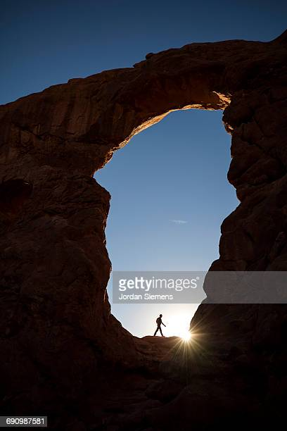 a man hiking in utah - distant stock photos and pictures