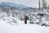 man hiking winter with backpack walking