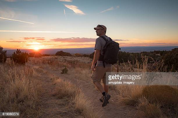 man hiking nature landscape - sandia mountains stock pictures, royalty-free photos & images