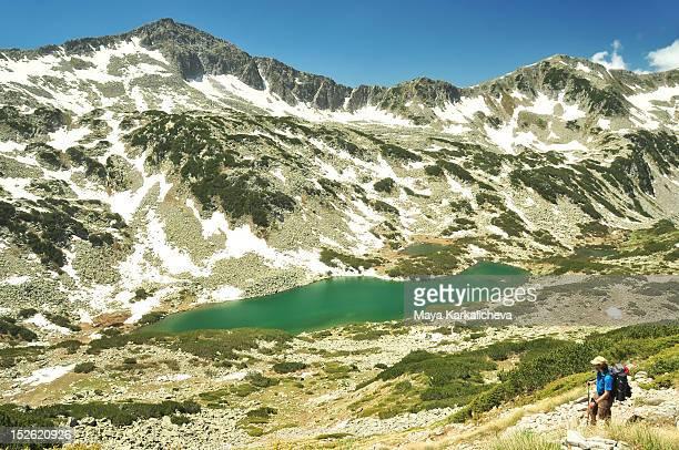 man hiking near mountain lake - pirin national park stock pictures, royalty-free photos & images