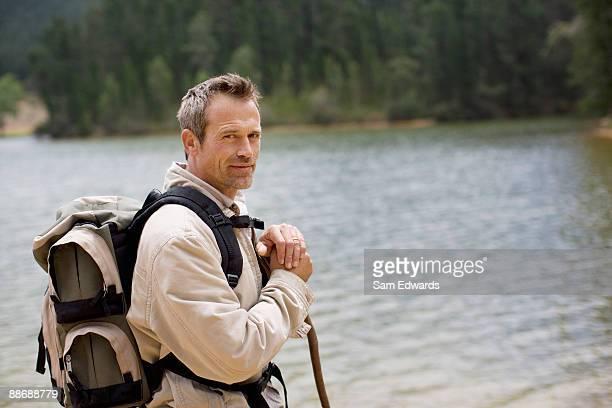 Man hiking near remote lake