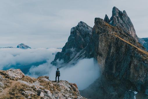 Man hiking near Seceda mountain in Dolomites 873509294
