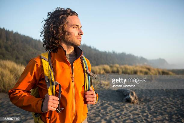 Man hiking near the ocean.