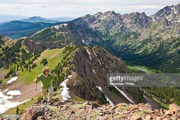 Man Hiking on Scenic Ridge High in the Mountains