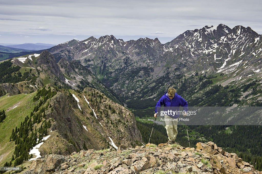 Man Hiking on Scenic Ridge High in the Mountains : Stock Photo