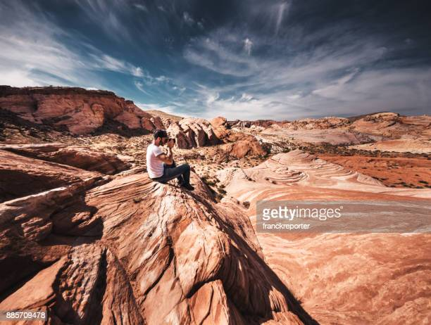 man hiking on the valley of fire state park - valley of fire state park stock photos and pictures