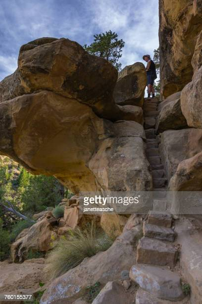 man hiking, petroglyph point trail, mesa verde national park, colorado, america, usa - mesa verde national park stock pictures, royalty-free photos & images