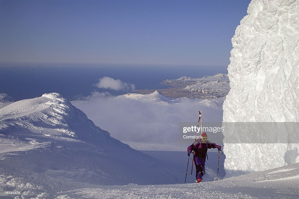 Man hiking to top of Snaefellsjokull volcano , Olafsvik , Iceland : Stockfoto