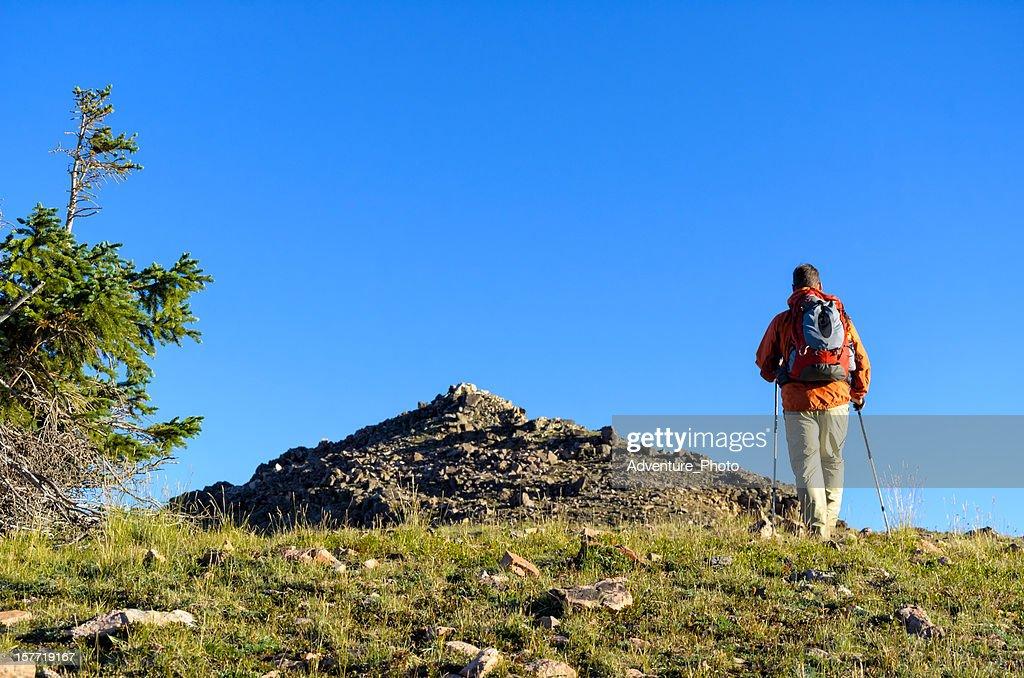 Man Hiking Toward Mountain Summit : Stock Photo