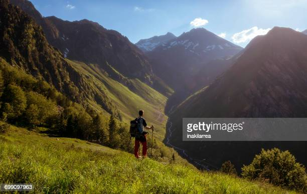 Man hiking, Valley of Ilheou, Pyrenees, France