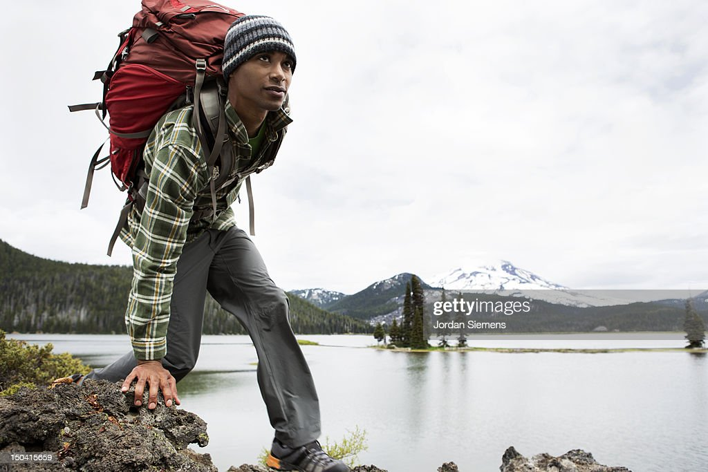 A man hiking with a backpack. : Foto de stock