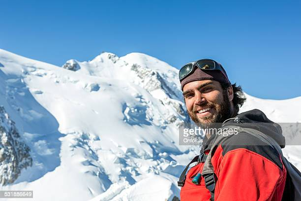 man hiking with mont blanc summit background, chamonix, france - aiguille de midi stock photos and pictures