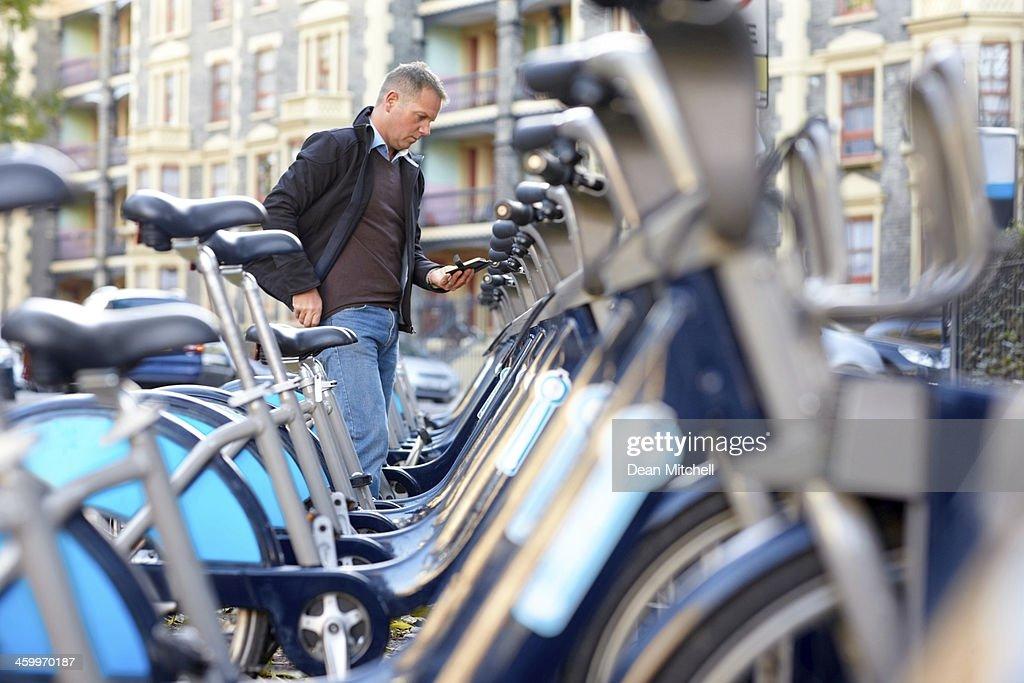 Man hiring a bicycle : Stock Photo