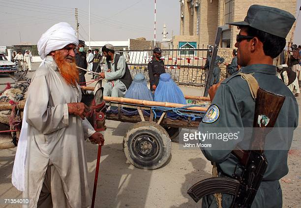 A man his beard colored with henna walks into Spin Boldak Afghanistan from Chaman Pakistan on July 2 2006 at the border in Spin Boldak Afghanistan...