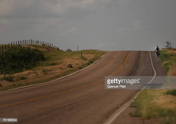 A man hitchhikes down a lonely stretch of highway June 27 2007 in Stockton KansasWhen rural America was chronicled 50 years ago by Jack Kerouac in...