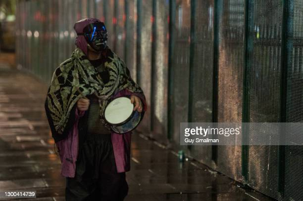 Man hits a drum in support of protesters in the tunnel late at night on February 5, 2021 in London, England. Earlier this week a High Court Judge...