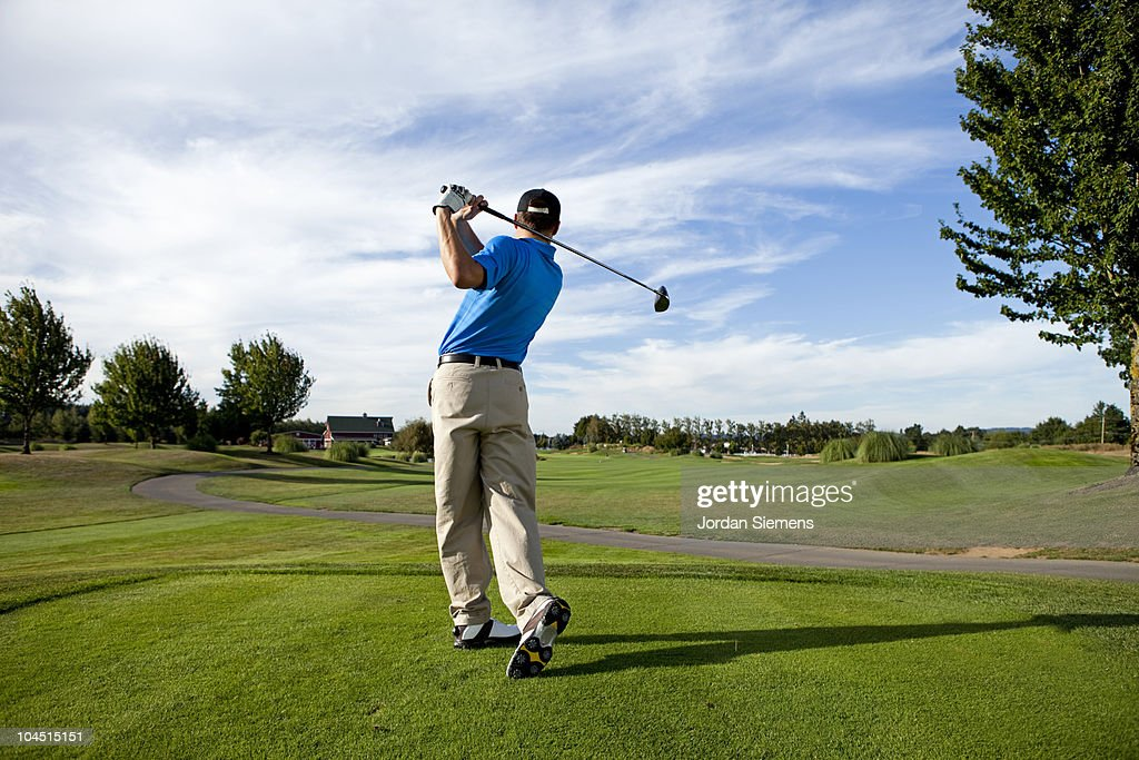Man hitting a ball on the golf course. : Stock Photo