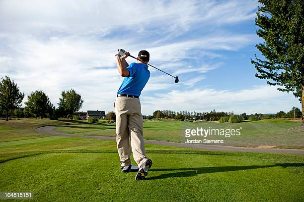 man hitting a ball on the golf course. - golfe imagens e fotografias de stock