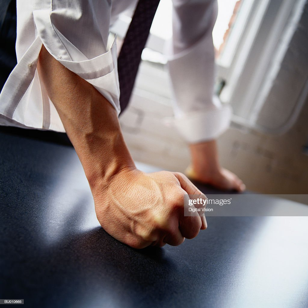 Man hitting table with fist, close-up : Stock Photo