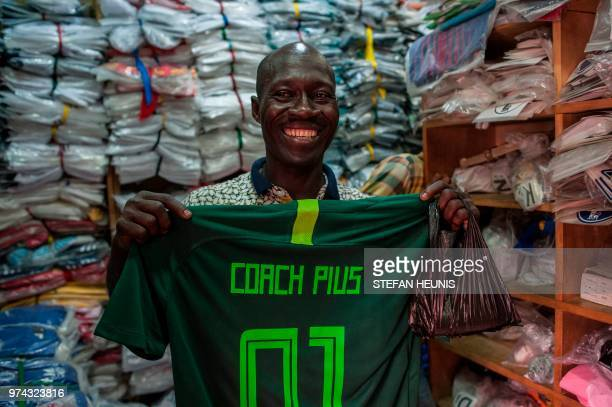 258bc95c0 A man hods up his new customized Nigerian World Cup jersey bought in a  store in