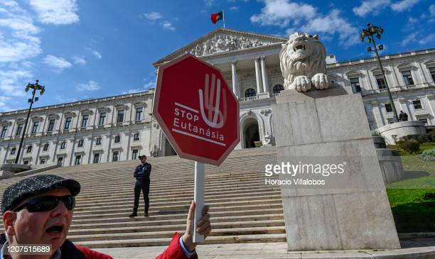 Man hoists placard and chant outside the Assembleia da Republica to demonstrate against bills that will legalize euthanasia on the day the project is...
