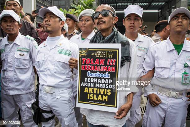 A man hold a poster protesting Facebook administration in blocking many of Indonesia Islam Ulama Facebook account Hundreds of muslims from Indonesian...