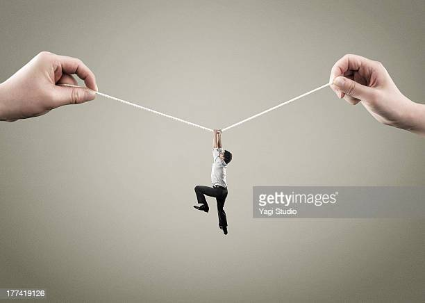 Man hold on to rope