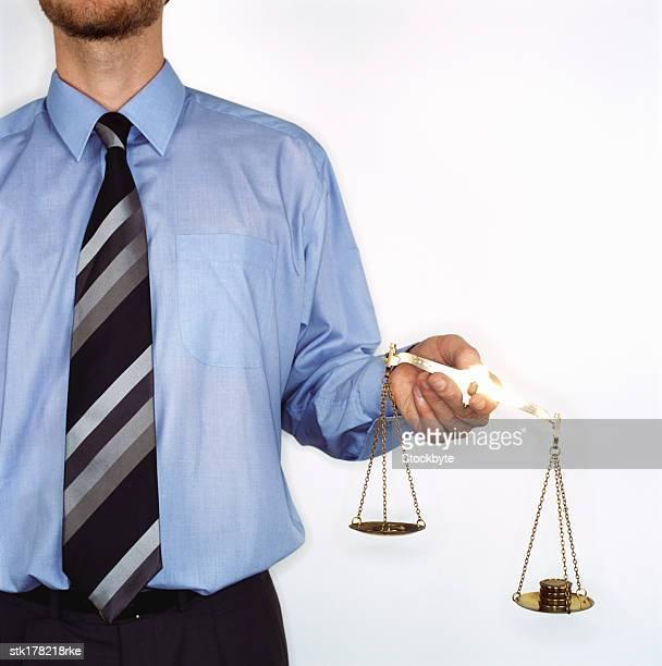 man holding a balance scale