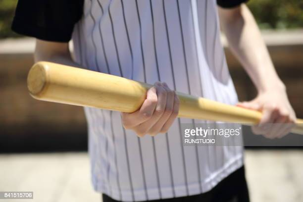 man holding a baseball bat - baseball bat stock pictures, royalty-free photos & images