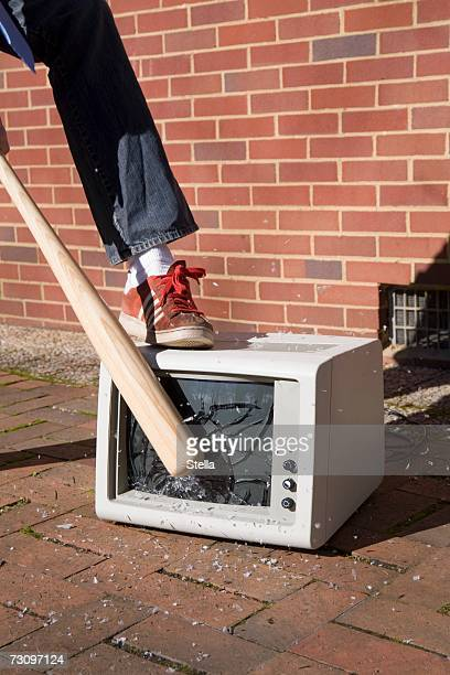 man holding a baseball bat to a smashed monitor - pants pulled down stock pictures, royalty-free photos & images