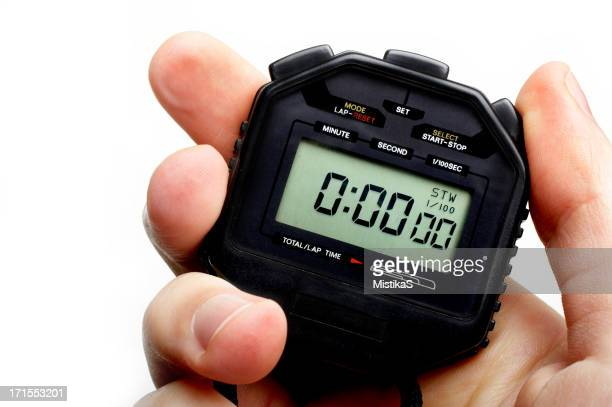 Man holding a black digital stopwatch set to zero