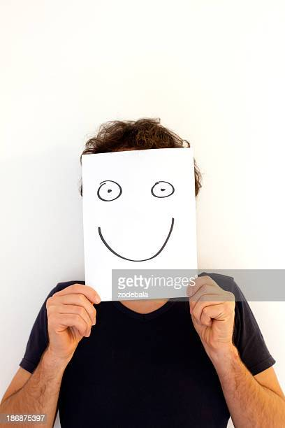 Man Holding a Blank Paper with Smiley Face
