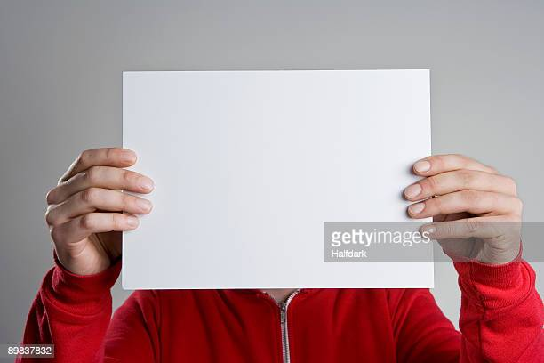 A man holding a blank sheet of paper
