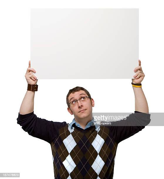Man holding a blank sign overhead on white background.