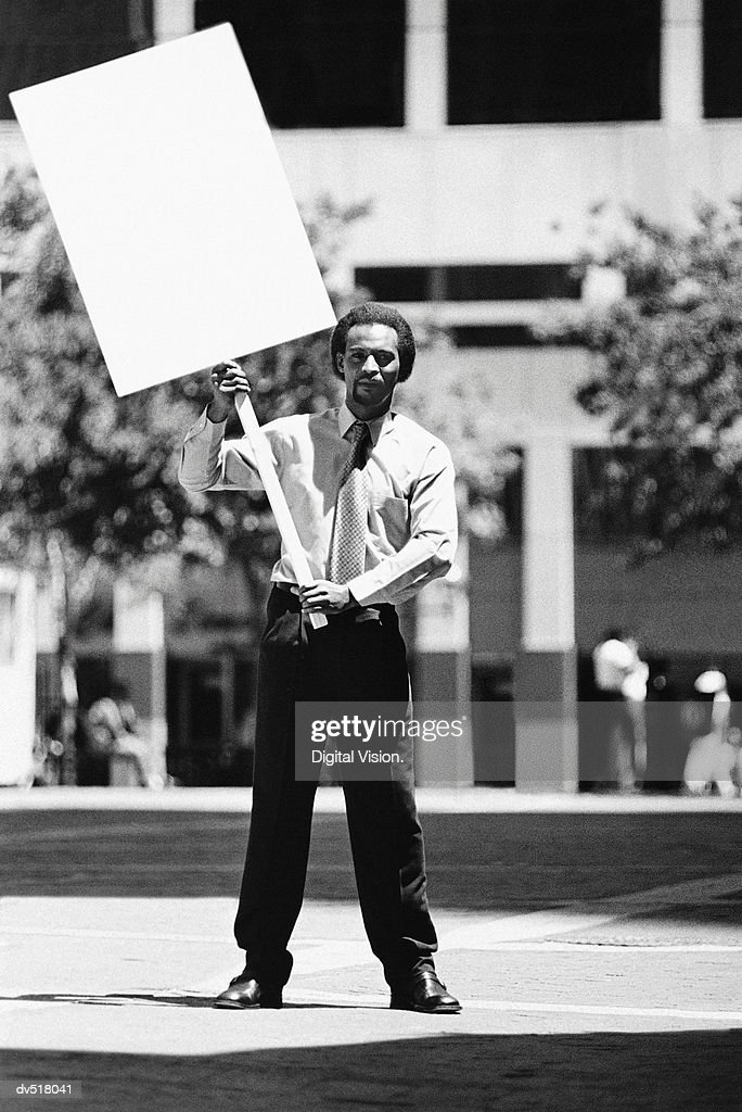 Man holding a blank sign : Stock Photo