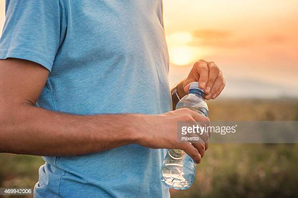 A man holding a bottle of water
