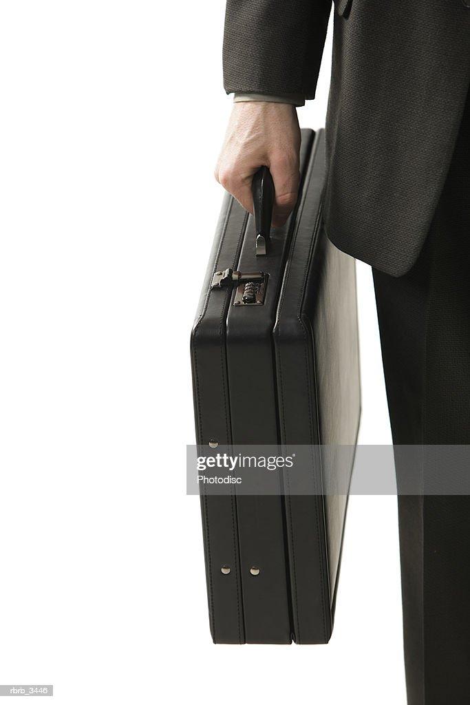 Man holding a briefcase : Foto de stock
