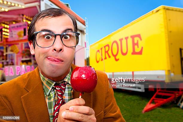 Man holding a candy apple at the carnival