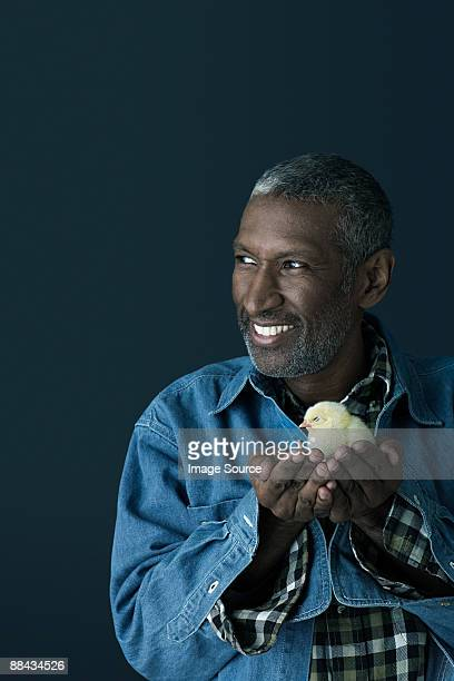 Man holding a chick