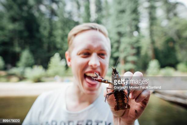 Man holding a crayfish