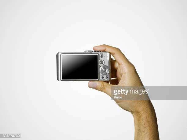 Man holding a digital camera
