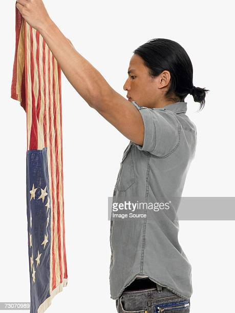 man holding a flag - betsy ross flag stock pictures, royalty-free photos & images